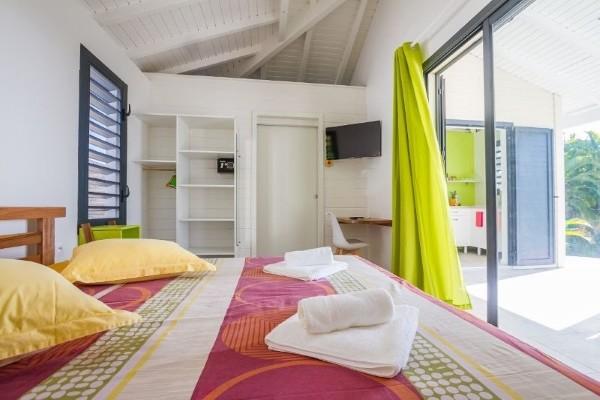 Chambre - Hôtel Iguane House Villas & Micro Spa + Location Voiture Pointe A Pitre Guadeloupe